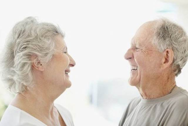 Old Couple Smiling At Each other
