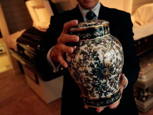 Man Holding Cremation Urn