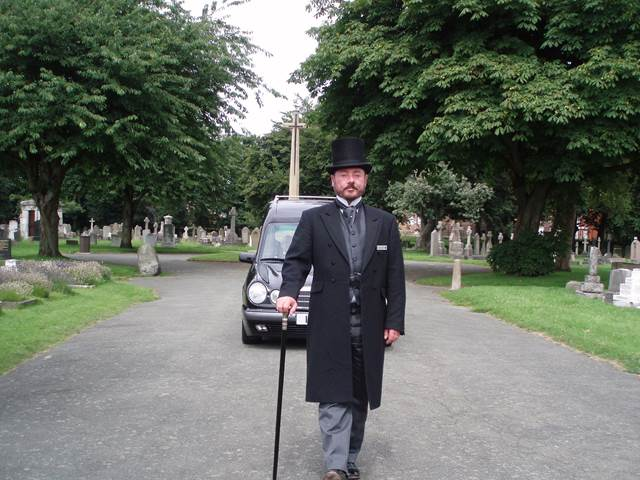 Funeral Director Leading Funeral Car