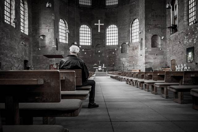 Older Man Praying In Church